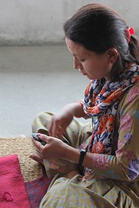 Nepali lady sewing hand made felt