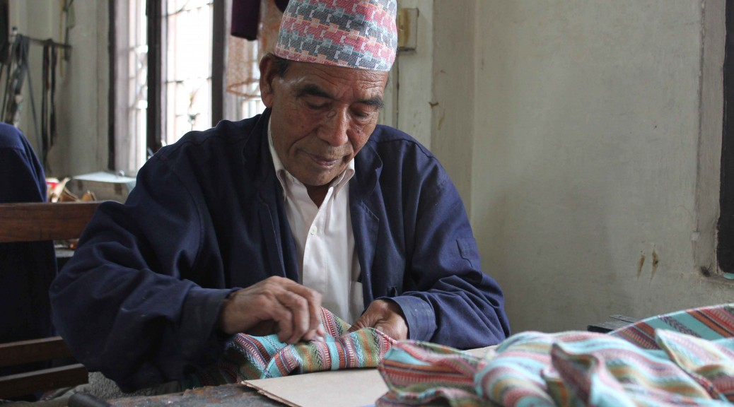 Nepali man making a handbag
